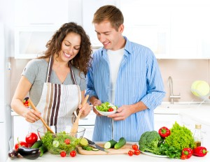 Happy Couple Cooking Together - Man and Woman in their Kitchen a